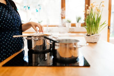56567880 - organic meal being made in modern kitchen on induction cooktop